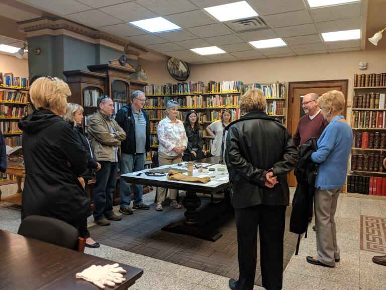 Matt Mayberry, CSPM Director, sharing some collection items as part of the Law and Disorder Walking Tour.