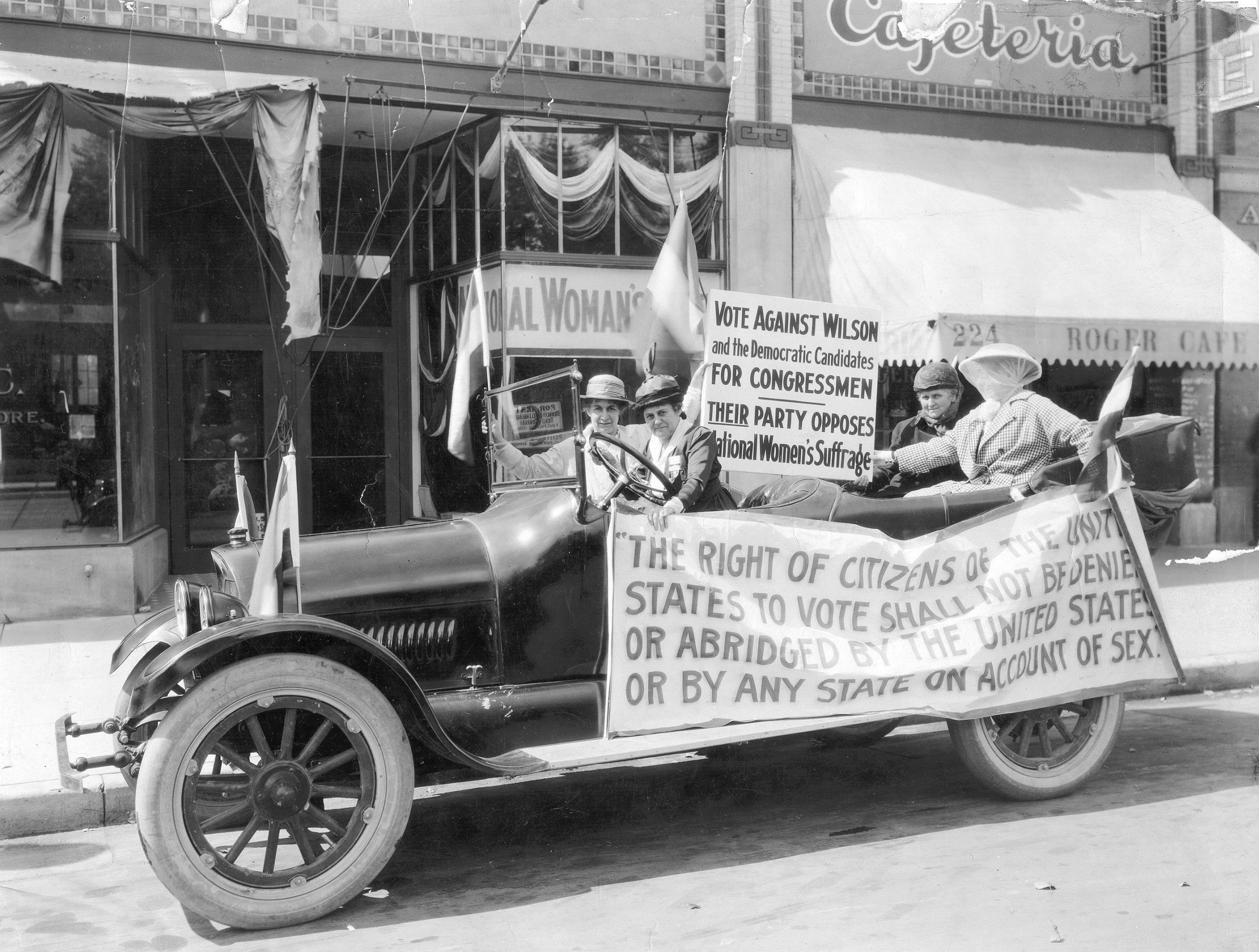Photo of car in front of the National Women's Party Headquarters in Colorado springs