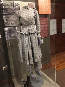 A photo of a bloomer dress on a mannequin in the Story of Us exhibit.