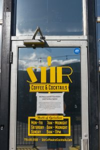 Store front of Stir with COVID-19 Sign