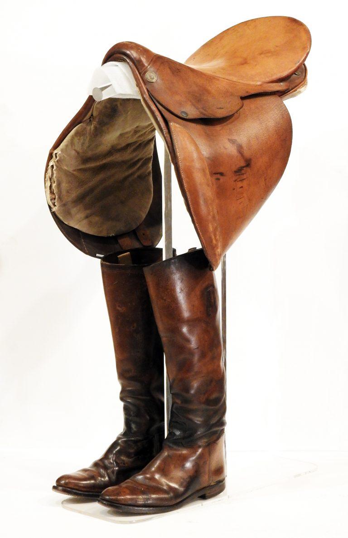 Raymond Lewis's Riding Boots and Saddle, ca. 1930. Generously Donated by Karine Kuehn, 2019.79.1, .2.