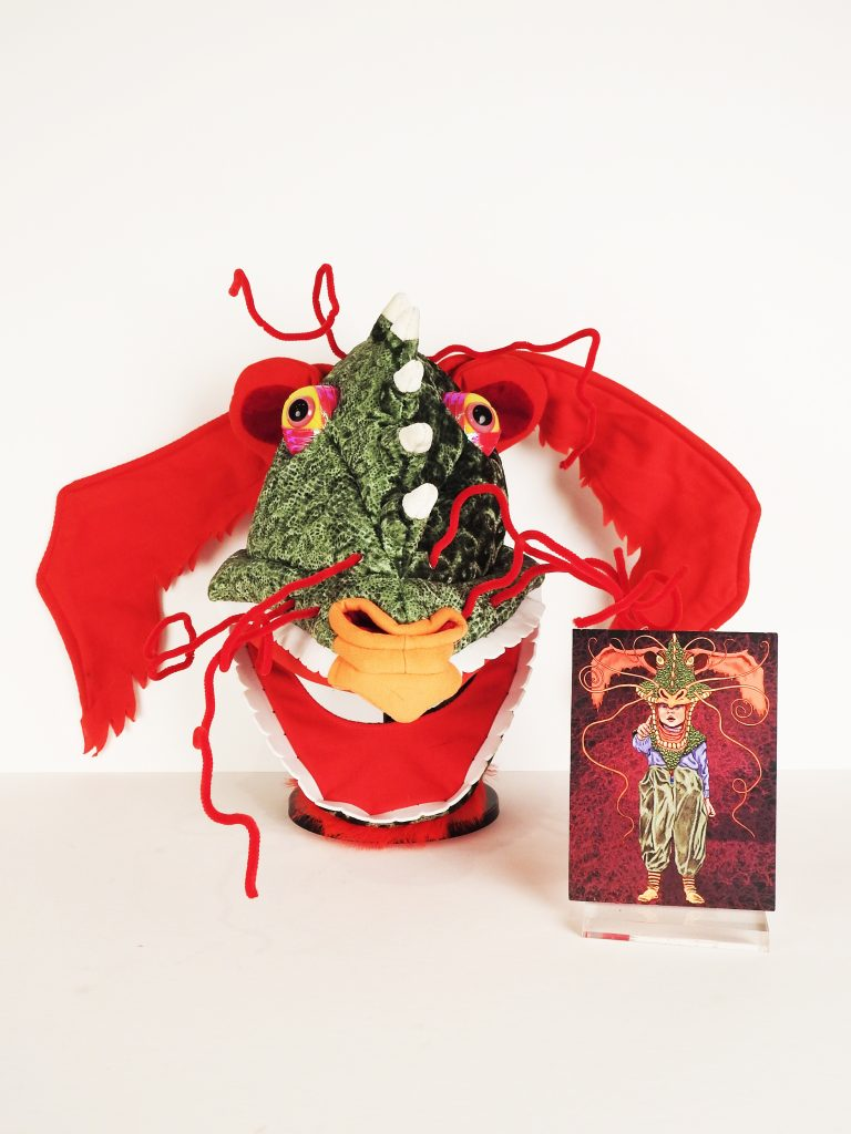 Imagination Celebration Dragon Mask, 2005, Michael Hague Dragon Card, 2005, Mary Mashburn's Magical Fairy Wand, Generously Donated by Deborah Thornton, Imagination Celebration. 2020.65.1