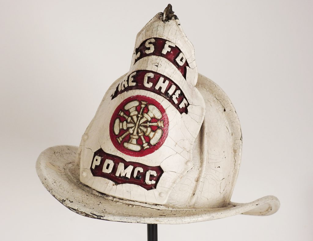 """Helmet of P.D. """"Patsy"""" McCartin, Chief of Colorado Springs Fire Department, 1909-1931. Generously donated by Mrs. F.L. Beyle, 45-40-1."""