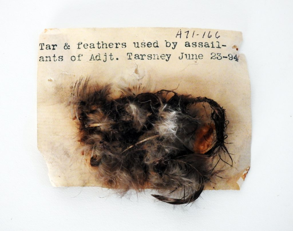 Tar and Feather remnants from kidnapping and assault of General Thomas J. Tarsney, June 1894. Generously donated by Oren Boling, 71-166-1, 2;