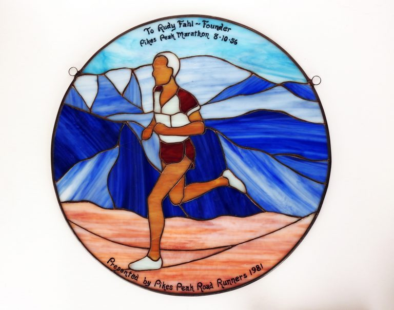 Leaded Glass Pikes Peak Marathon Runner, 1981. CSPM Collection, PM-88-145
