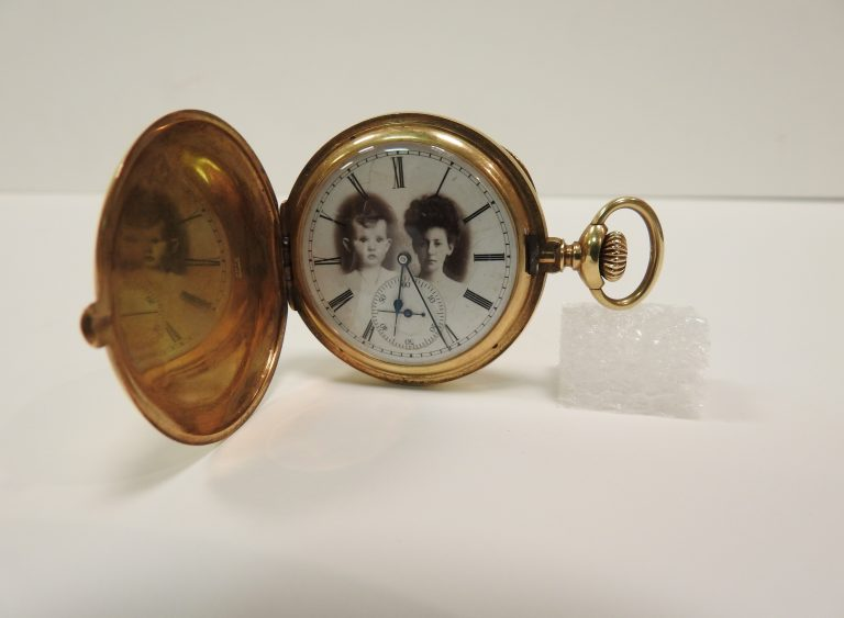 """Interior of pocket watch featuring photos of Oly Belle and James F. Burns Jr. given to James F. """"Jimmie"""" Burns, 1904, Courtesy of James and Kimberly Burns"""